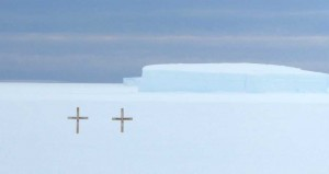 Two plain wooden crosses to remember the victims of the helicopter crash in the whiteout.